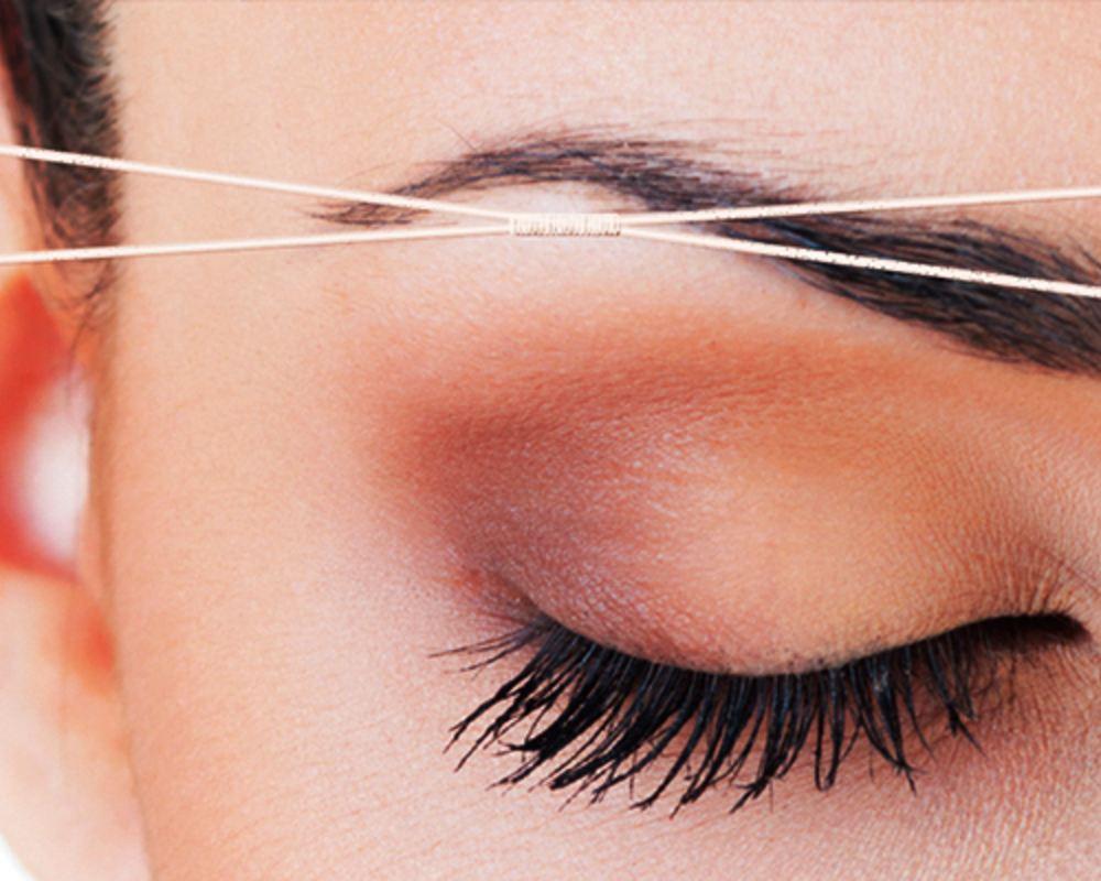 Фото: Коррекция бровей нитками